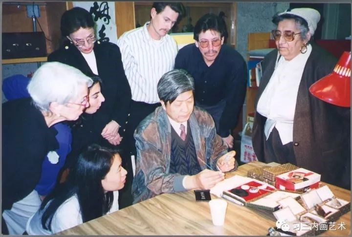 Wang Xi San demonstrating inside painting during an international exchange and exhibition